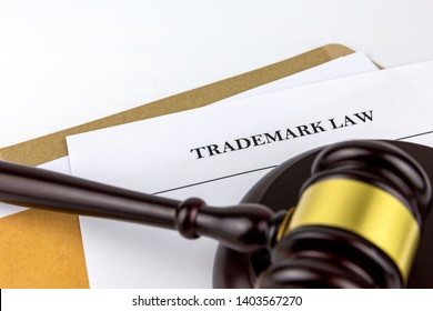 Judges gavel or hammer on document of prosecution about Trademark Law in brown envelope.Concept of  litigation and verdict of attorney.