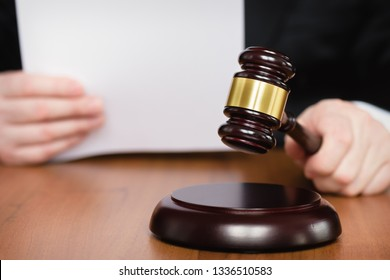 Judge's gavel in hand. Judge passes sentence. Lawyer and court. Judge hits the table with hammer. In the courtroom, the judge convicted lawyer.
