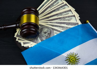 Judge's gavel with money and argentinian flag