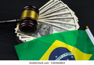 Judge's gavel with money and brazilian flag