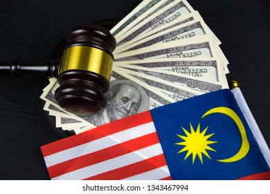 Judge's gavel with money and Malaysian flag