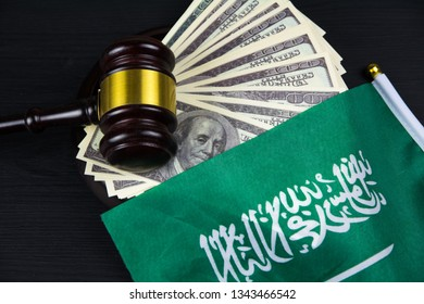 Judge's gavel with money and Saudi Arabia flag