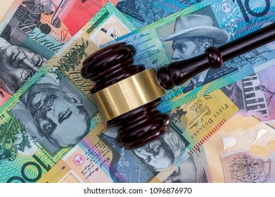 Judge's gavel on australian dollar banknotes, closeup
