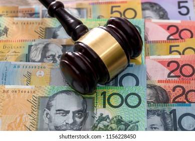 Judge's gavel on australian dollars, justice concept