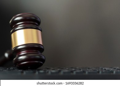 Judge's gavel on computer keyboard with copy space. Cyber crime, law and justice concept