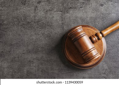 Judge's gavel on grey background, top view. Law concept