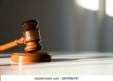 Judges gavel on grey background.