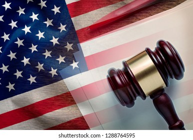 Judges gavel on a legal document with pen overlaid with the United States flag conceptual of law enforcement in America