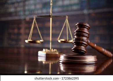 Judge's gavel on library background. Law and justice concept.