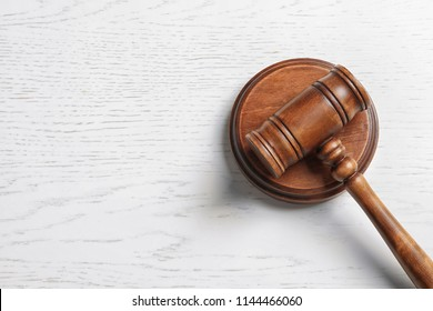 Judge's gavel on light background, top view. Law concept
