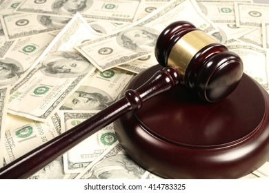 Judge's gavel on top of american currency
