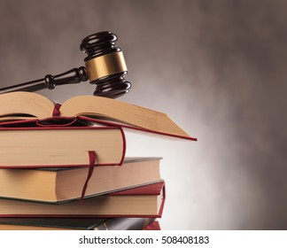 judge's gavel on top of a stack of books with copyspace in studio