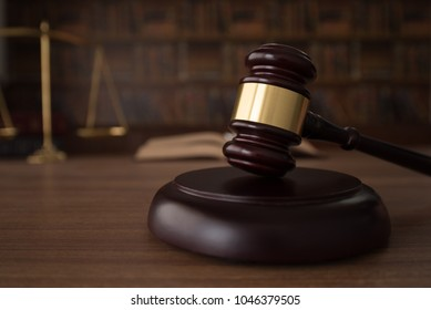Judges gavel on wooden table with law books and scales of justice. Legal,Law,Legislation Concept.