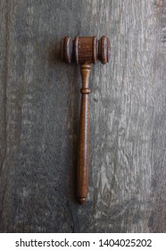 judge's gavel on wooden table - top view - law concept
