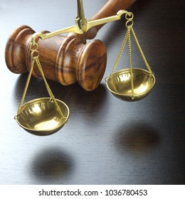Judges Gavel And Scale Of Justice On The Black Table Frame Background  In Back Light. Overhead View. Law Concept