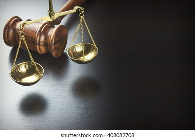 Judges Gavel And Scale Of Justice On The Black Wood Background, Top View. Law Concept