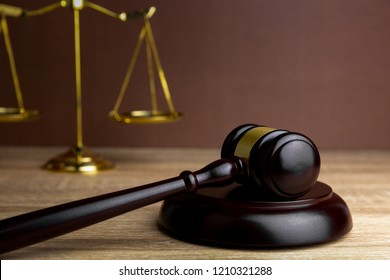 Judges gavel and scales for judgment in courtroom or hammer for auction on wooden.litigation and prosecution concept.