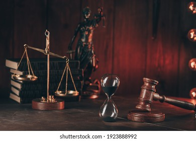Judge's gavel, scales, lady of justice and hourglass. Law and justice concept