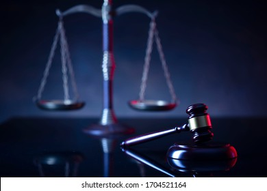 Judge's gavel, scales, statue of justice. Red light. Law and order social justice  concept.