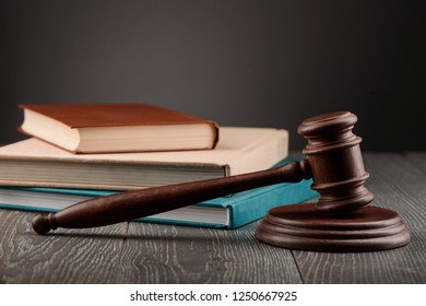 Judge's gavel and stack of books. Judiciary, legal education at a jurisprudence faculty.