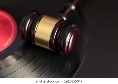 Judge's gavel and vinyl record. Concept of entertainment lawsuit, music piracy and copyright protection