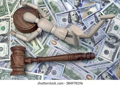 Judges Gavel, Wooden Human Figurine Laying On The Sound Block And Money Dollar Background