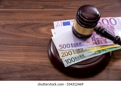 Judge's hammer with  Euro currency