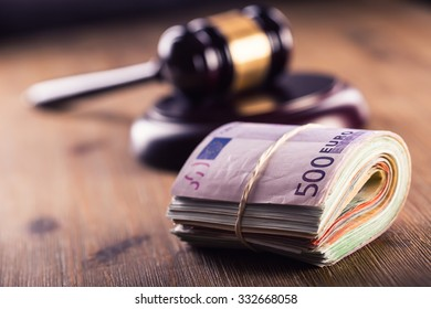 Judge's hammer gavel  and rolled Euro banknotes. Representation of corruption and bribery in the judiciary.