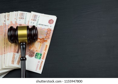 Judge's hammer gavel and rubles money and space for text close up