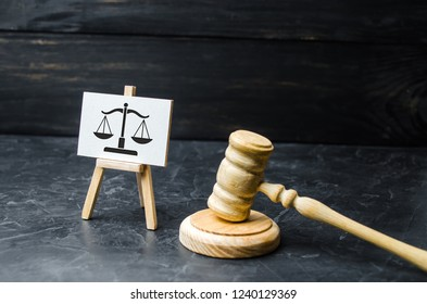Judge's Hammer and Scale Sign. The concept of the court and the judiciary, justice. Respect for the rights of man and citizen, the resolution of conflict situations and the issuance of verdicts.