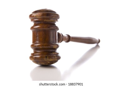 A judges wooden gavel on a white background