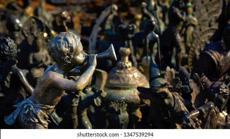 Judgment Day. Figurine depicting a cherub playing the trumpet, and others