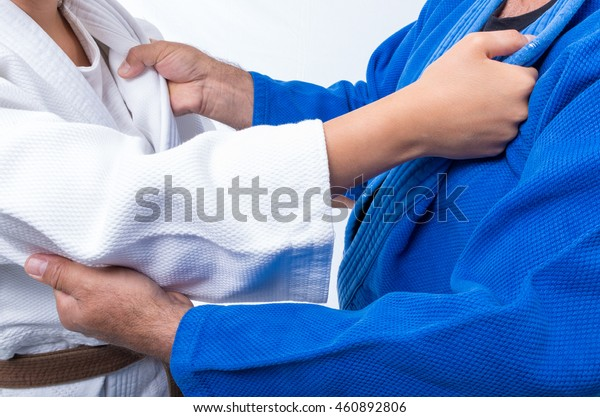 Judo Gripping between female judo brown belt and her sensei black belt
