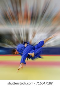 Judoka in blue judogi throwing his opponent for ippon with amazing Uchi Mata
