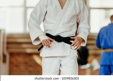 judoka white kimono with black belt competition judo