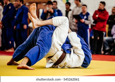 judoka wrestlers man winning throw ippon in judo competitions