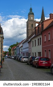 JUETERBOG, GERMANY - MAY 23, 2021: Streets of old town. In the background, the Church of St. Nicholas. Juterbog is a historic town in north-eastern Germany, in the district of Brandenburg.