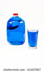 Jug of Blue Water with Glass of Blue Water - got Blue ?  Bright Blue colored water in a Jug and Glass on a white background