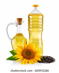 Jug and Bottle of Sunflower oil with flower and seeds isolated on white