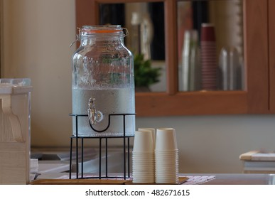 Jug of cold water and glass paper