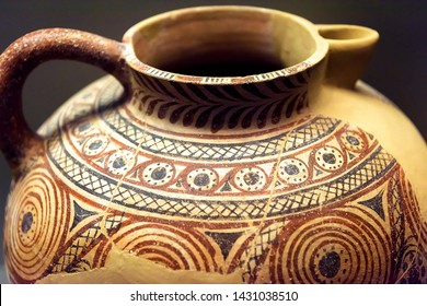 Jug from the excavations in Greece. Painted archeological pottery. Remains of Ancient Greek culture. Vintage terracotta ceramic with ornament. Old Greek patterned pottery close-up.