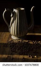 jug and fresh coffee grains on a table
