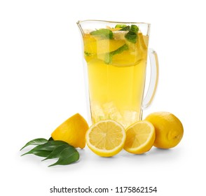 Jug of fresh lemonade on white background