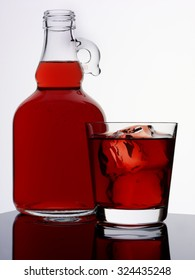 JUG AND GLASS OF POMEGRANATE JUICE