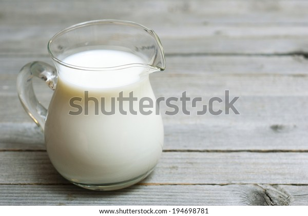 a jug of milk on wooden table