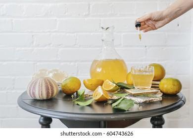 A jug of orange juice and fresh fruit