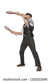 Juggler juggling pins on white background