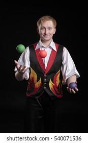 juggler on a black background