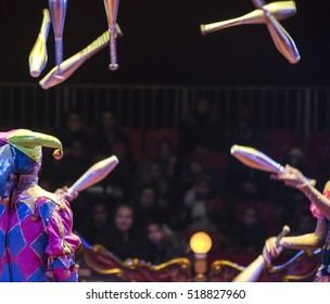 Jugglers in the circus and audience blurred