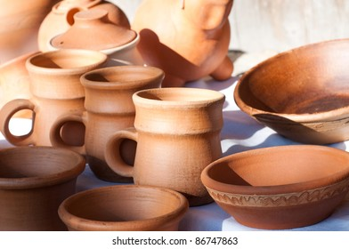 Jugs and plates in in the morning light
